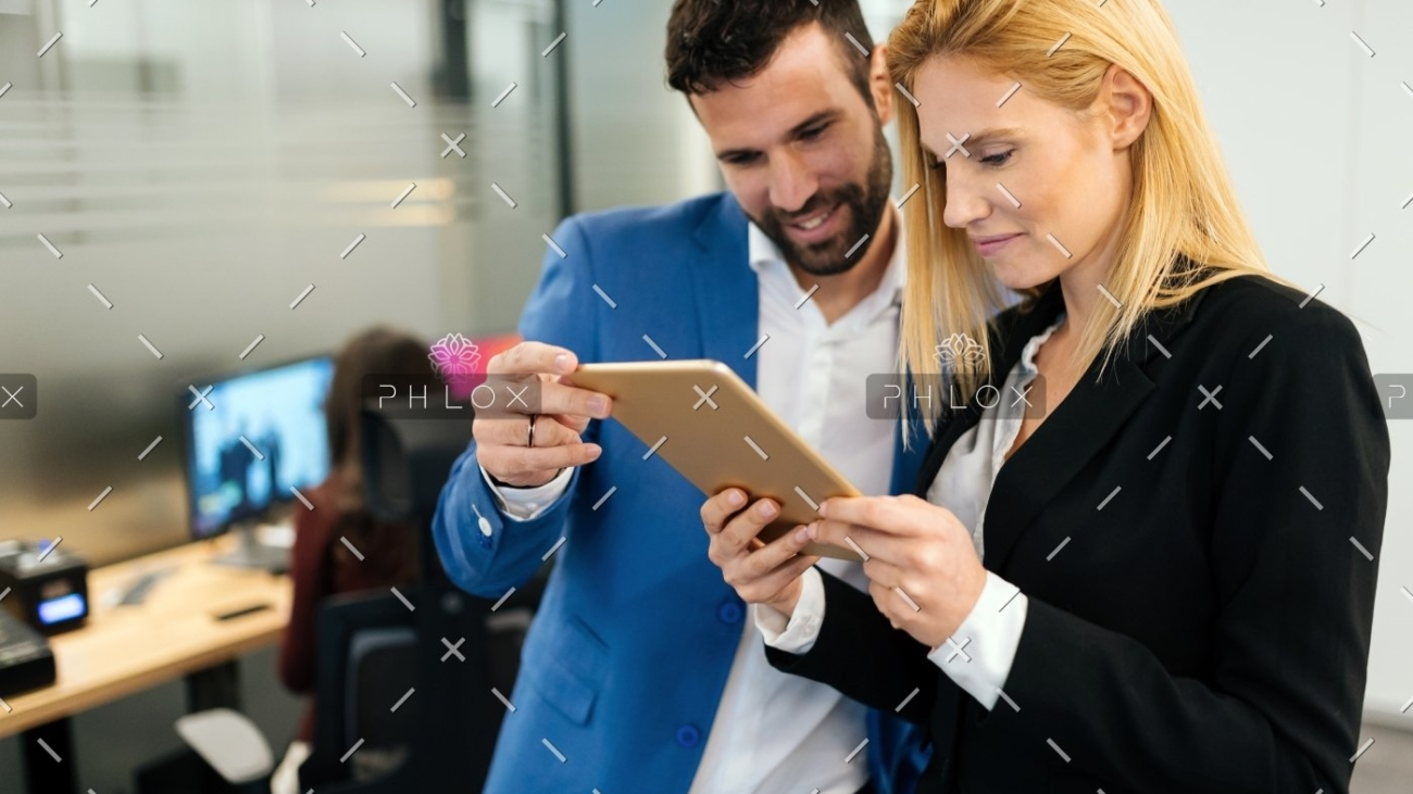 demo-attachment-143-businesspeople-discussing-while-using-digital-WFGVC3X