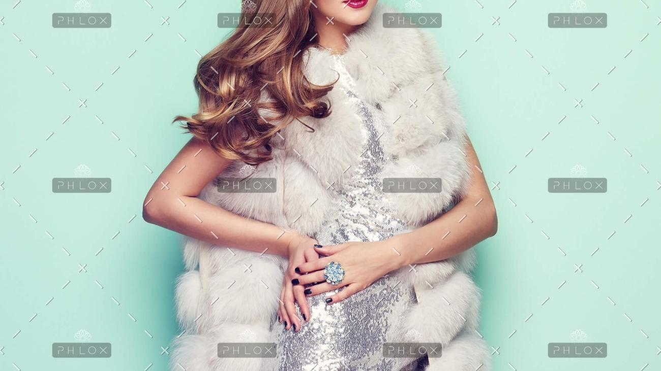 demo-attachment-77-fashion-portrait-young-woman-in-white-fur-coat-PZ74KRU